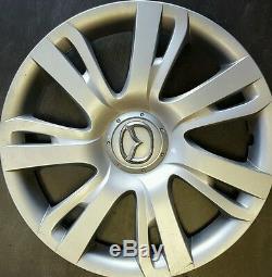 Four 15 Mazda 2 Seven Spoke Split 11-14 Couvre Enjoliveur Hubcap Argent 570-56556
